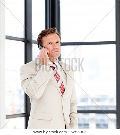 Senior Businessman Speaking On A Mobile Phone