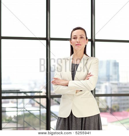 Beautiful Confident Businesswoman With Folded Arms