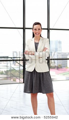 Beautiful Smiling Businesswoman With Folded Arms