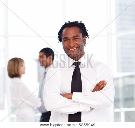 African Businessman With Folded Arms Smiling At The Camera