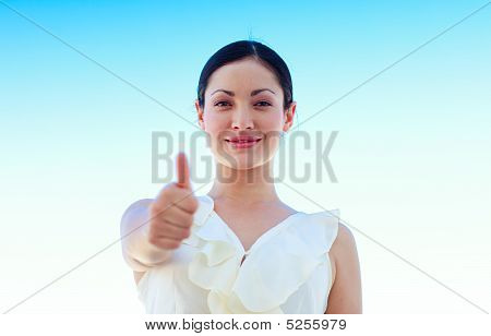 Young Businesswoman Outdoors With Thumbs Up