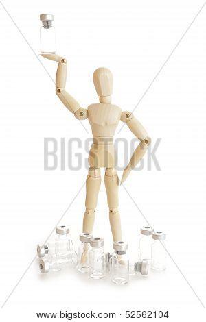 Wooden figure holding medicine injector vial