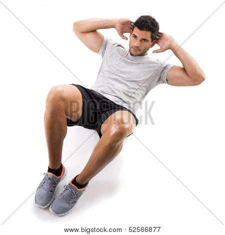 Athletic man running doing abdominals, isolated over a white background
