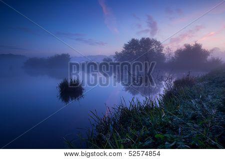 Misty Sunrise Over Lake