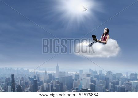 Female Student Looking At Dove With Laptop