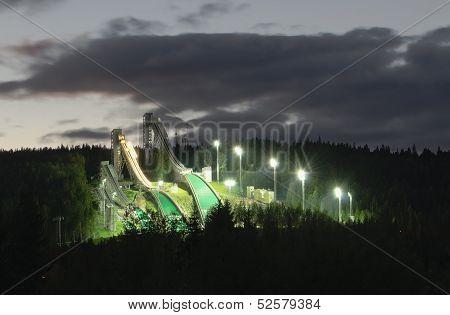 Ski Jumping Hills In Night-time Lighting