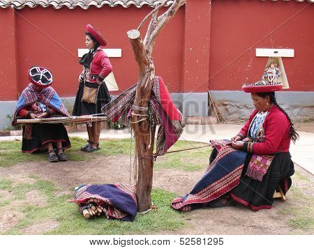 Women show process of making of the clothes.