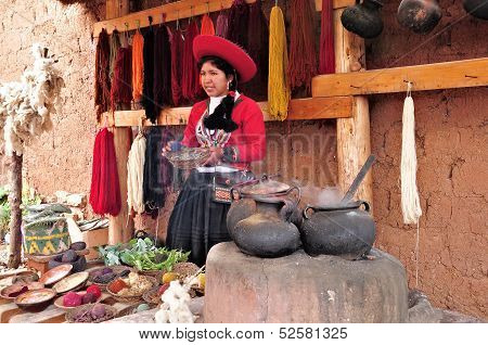 Young woman shows and tells about production of the clothes.