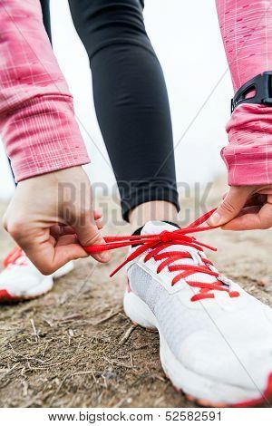 Woman Runner Tying Sport Shoes
