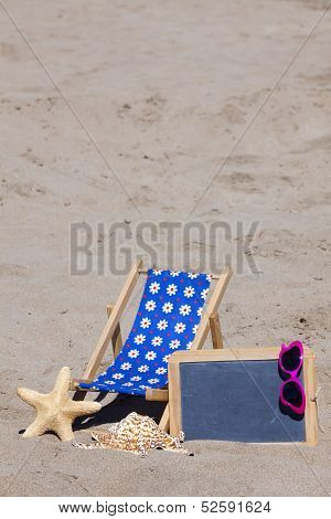 Beach Scene With Sun Chair And Blackboard