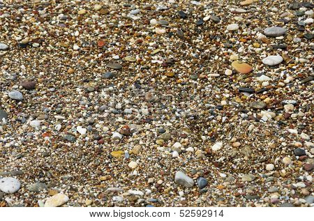 Wet pebblestones on sea beach