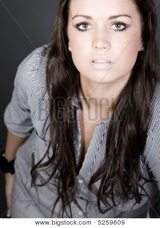 Long Haired Teenager Against Gray Background