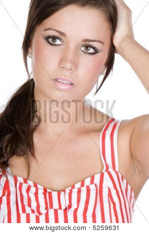 Shot Of A Pretty Teenager With Sad Expression On Her Face