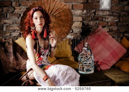 Red Hair Woman On Sofa With Parasol