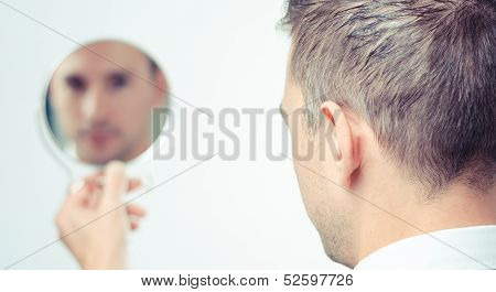 Businessman Looking In The Mirror And Reflecting