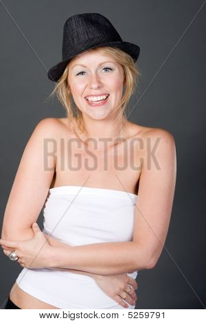 Shot Of A Pretty Blonde Girl In Hat Laughing