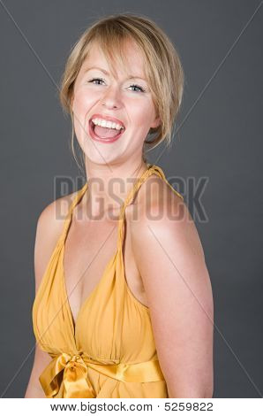 Shot Of A Pretty Blonde Girl In Yellow Dress Laughing