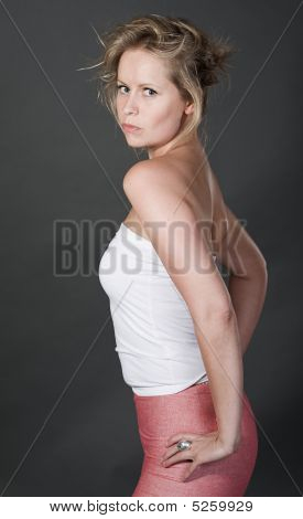 Fashionable Blonde Girl On Grey Background