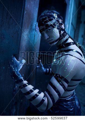 Man with creative face-art. Cyber zombi style. Shot in destroyed building.