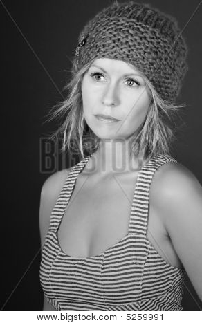 Stunning Black And White Shot Of A Beautiful Blonde Girl In Hat Against Grey Background