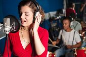 picture of singer  - Female playback singer recording a track at studio - JPG