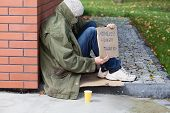 picture of begging  - Poor homeless begging for money on a street - JPG