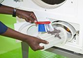 pic of laundromat  - Close up of cleaning the laundromat - JPG