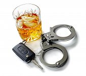 stock photo of whiskey  - Whiskey with car keys and handcuffs concept for drinking and driving - JPG