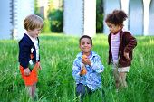 picture of arch foot  - Children playing with water gun in the grass - JPG