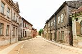 stock photo of cobblestone  - Old city cobblestone street in Latvia Kuldiga - JPG