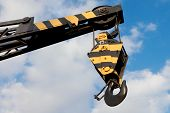 picture of weight lifter  - crane hook on a blue sky background - JPG