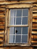 picture of stagecoach  - Broken window in abandoned stagecoach station in Colorado - JPG