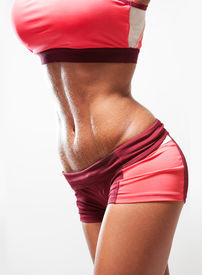 picture of wet pants  - Super fit young woman showing off her perfect muscular abs - JPG