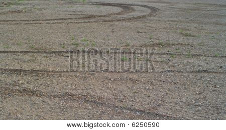 Traces From Wheels On Stony Soil