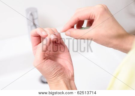 Woman Shaping And Cleaning Her Cuticles