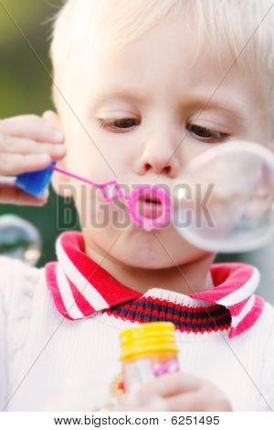 Portrait Of Boy Making Bubbles