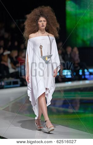 ZAGREB, CROATIA - MARCH 28, 2014: Fashion model wearing clothes designed by Marina Design and Marija Ivanovic necklace on the 'Fashion.hr' fashion show