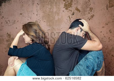 Divorce,fight,problems - Young couple angry at each other sitting back to back