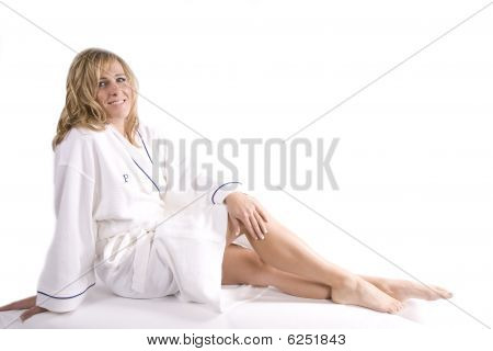 Woman Sitting In White Robe