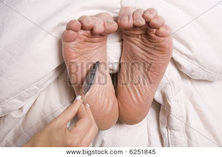 Woman Tickling Man's Feet