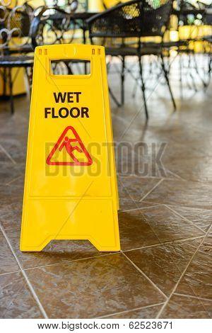 Yellow wet floor sign.