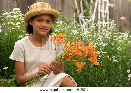 Girl In The Garden With Flowers