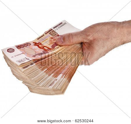Heap of One Million Russian  Banknotes Rubles in man hand - isolated on white background