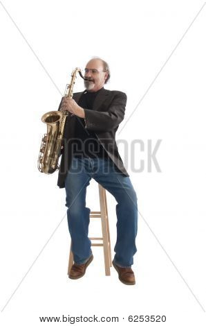 Playing A Tenor Sax Seated On A Stool