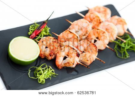 Skewered prawns (yakitori) with sauce isolated on white