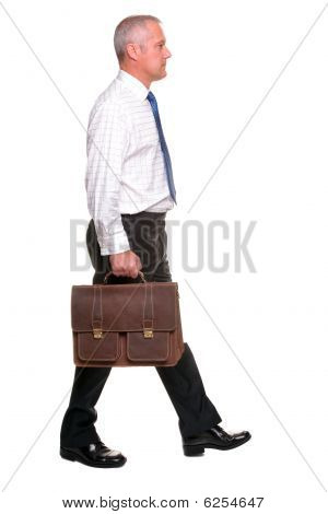 Mature Businesman Walking, Side View.