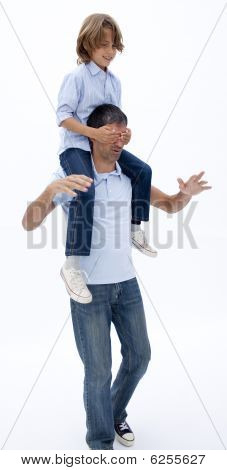 Father Giving Son Piggyback Ride With Eyes Closed