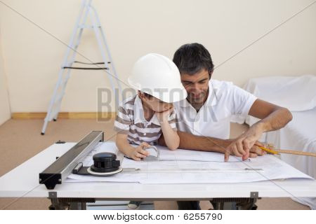 Father And Son Studying Working With Plans