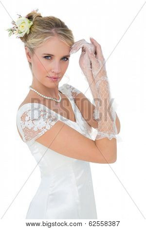 Portrait of sensuous bride posing over white background