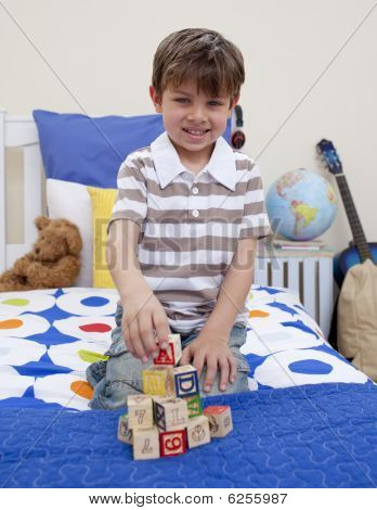 Little Boy Playing With Alphabet Cubes